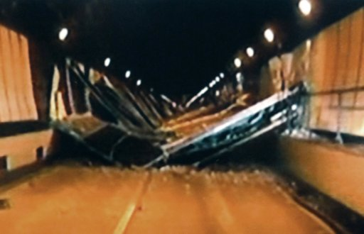 In this image made off video footage taped Sunday afternoon, Dec. 2, 2012 by Yamanashi Prefectural Police and distributed Monday by Kyodo News, concrete ceiling panels collapse inside the Sasago Tunnel on the Chuo Expressway in Koshu, Yamanashi Prefecture, central Japan. The structure fell onto moving vehicles deep inside the tunnel Sunday morning, and authorities confirmed nine deaths before suspending rescue work Monday while the roof was being reinforced to prevent more collapses. (AP Photo/Kyodo News)