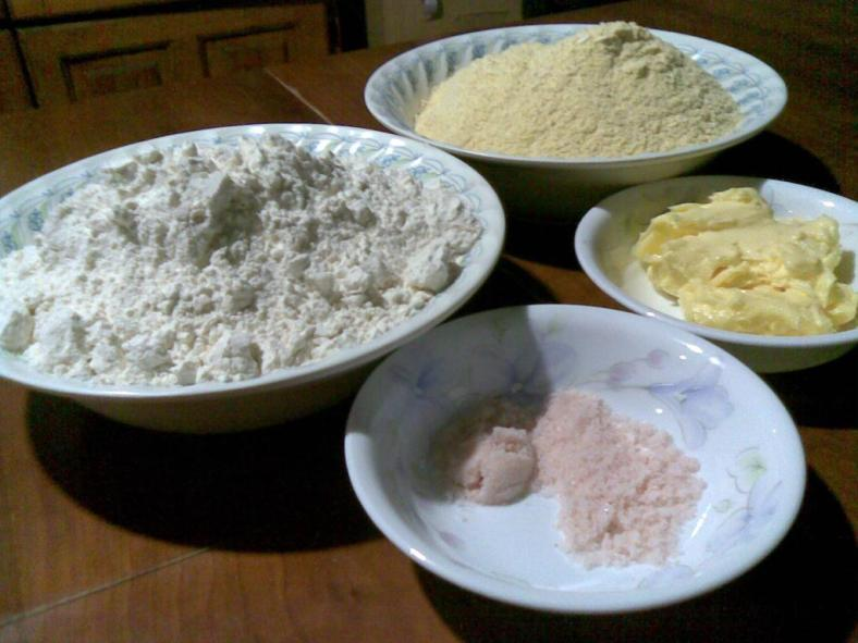 Clockwise from the top: Cornmeal, Butter, Salt, Wheat Flour.