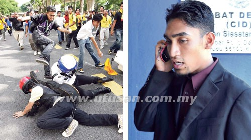 This picture proves that Khalid Ismath participated the Bersih 3.0 demonstration and had also kicked a police.
