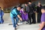Members of the secretariat carrying Kalthum Omar during the Wacana Agenda Kristian Se Dunia: Rujukan Khas Malaysia at the Dewan Muktamar, Pusat Islam.