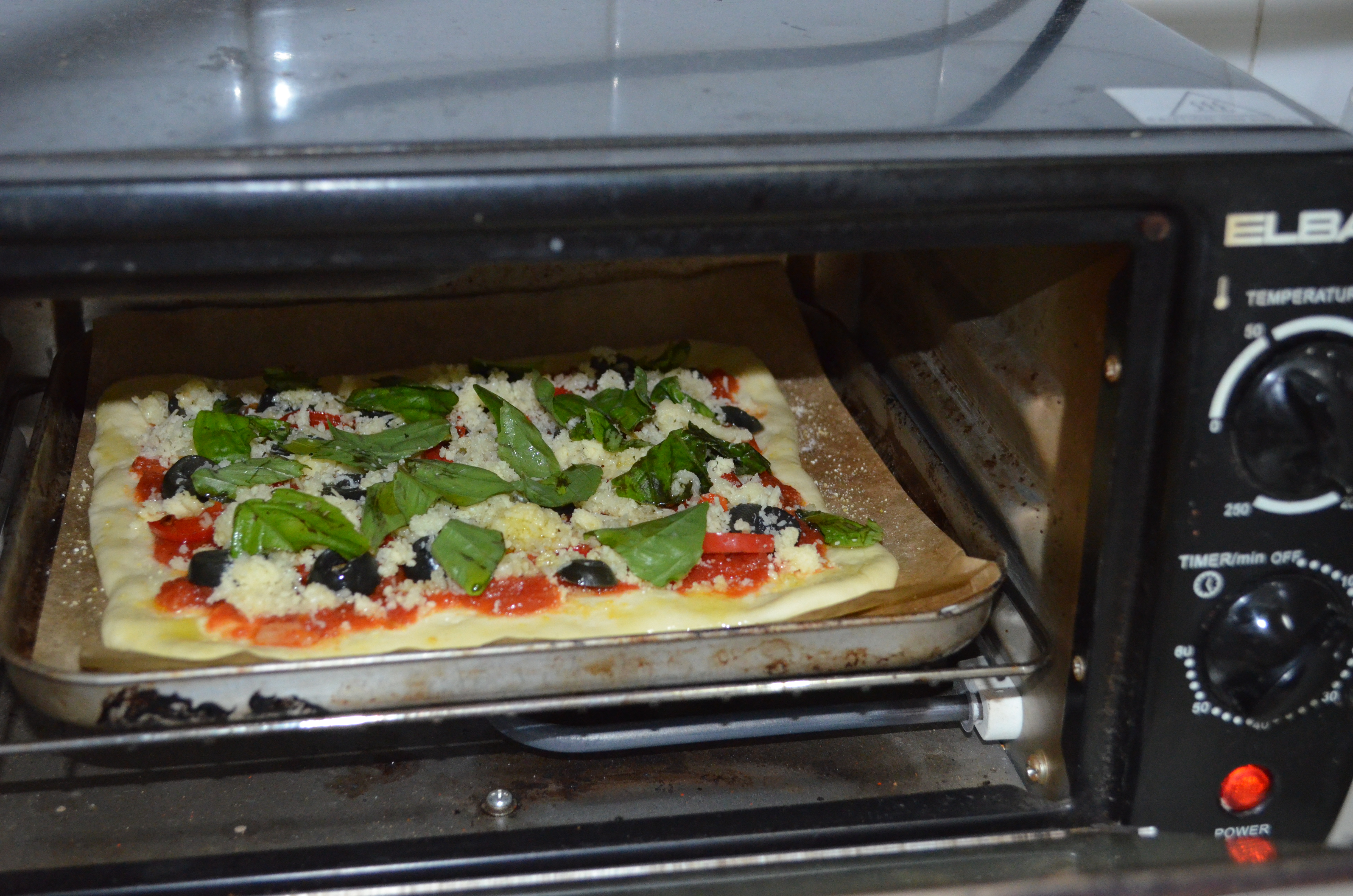 You can even use a toaster oven to bake the pizza!