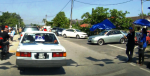 A BN supporter waving the BN flag as a car with a BN car sticker on it passes by during the polling day of the N.25 Kajang by-election.